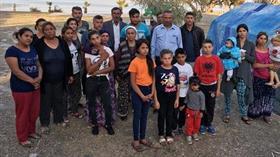 İzmir'in Urla ilçesinde mahallelerinden kovulan 11 kişilik aile iskelede yaşam mücadelesi veriyor