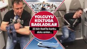 33 bin feetteki uçağın kapısını açmak isteyen sarhoş yolcuyu koltuğa bağlayarak durdurabildiler